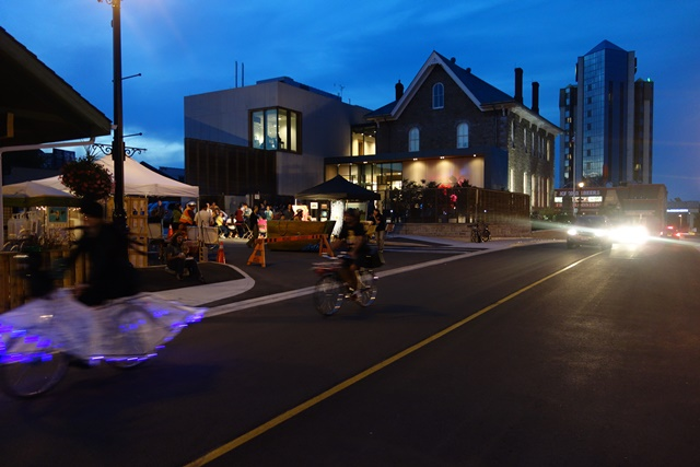 Night of Art 2015 showing the back of the Niagara Falls History Museum, artists in the Bike Parade and other activities taking place