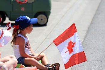 Young girl holding a Canadian flag