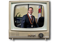 Mayor Jim Diodati on a Television screen