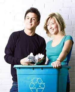 Couple holding a recycling box
