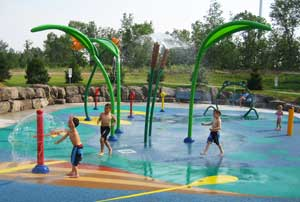 Kids playing in the Splash Pad at the MacBain Centre