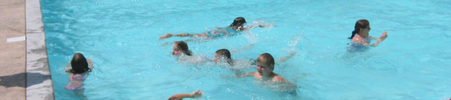 Kids in the summer swimming at a public pool